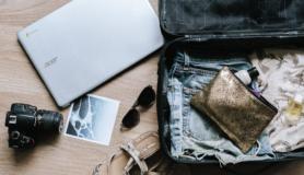 Digital Nomad packs suitcase