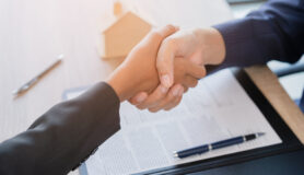 Shaking hands after signing a lease