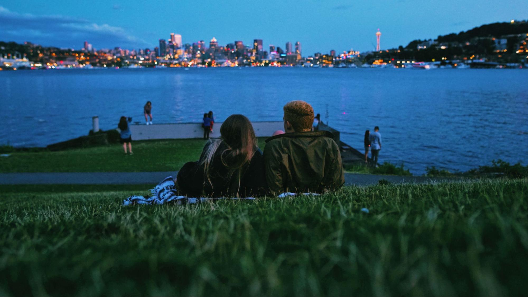 Couple looks over the city of Seattle