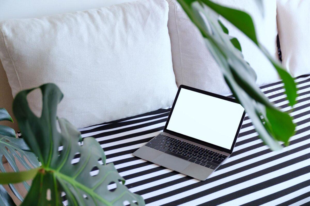 Computer on a bed as part of a flexible living arrangement.