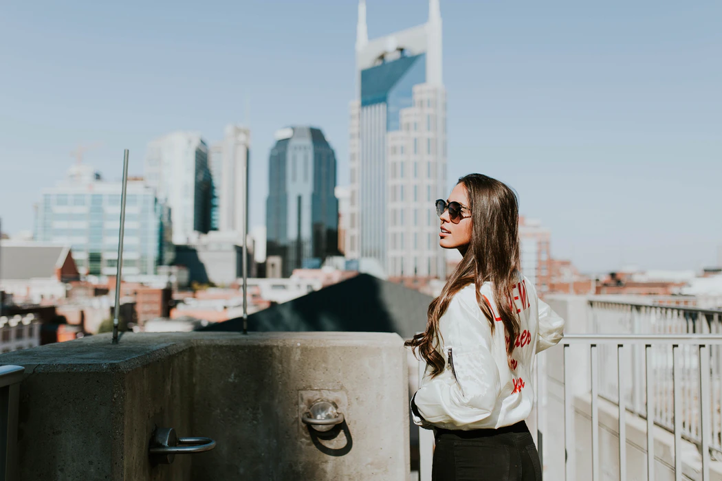 Woman looks out over Nashville, TN.
