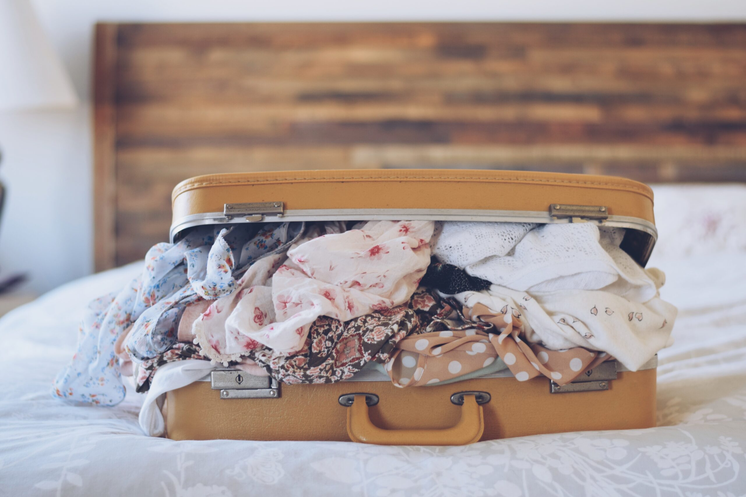 A suitcase on the bed.