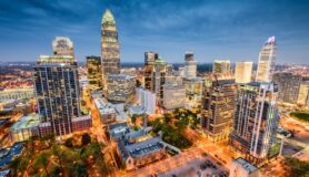A birds-eye view of the city of Charlotte at nighttime.