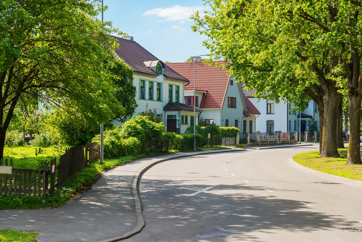 Beautiful street with modern residential houses in summer sunny day in the suburbs.