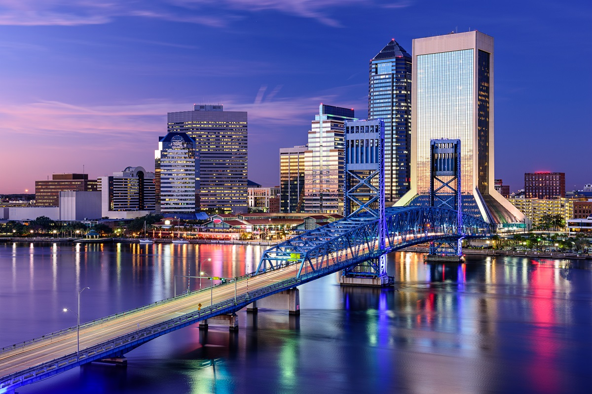 The Jacksonville, Florida, city skyline at night on the St. Johns River.