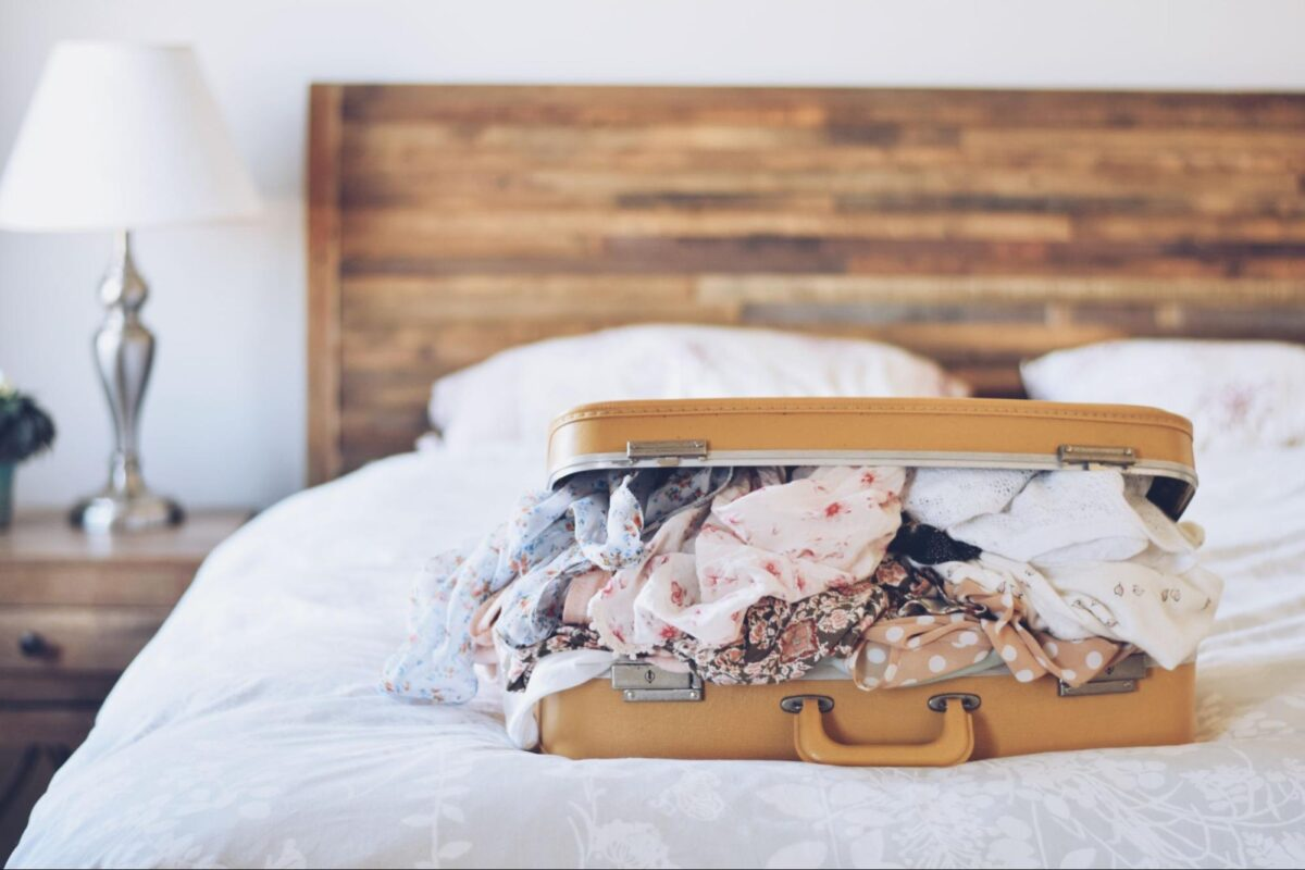 Digital nomad suitcase on the bed